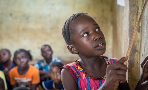 A girl reads in Sierra Leone