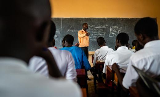 Children learn in a classroom in Uganda