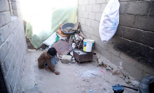 Abed*, 11, plays outside his home in North-West Yemen.