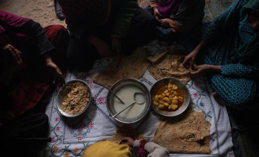 Hamida*, 11, eats with her family at home before going to school supported by Save the Children in a village outside Kandahar, February 3, 2020.