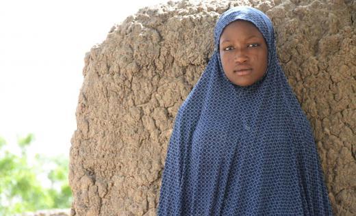 Haouaou, 17, outside her home, Maradi, Niger