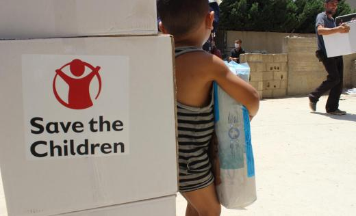 Save the Children is providing food parcels to vulnerable families in this collective shelter