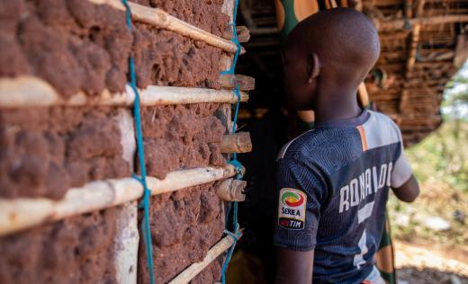 Luis* (14) lives with his neighbour Andre* (71) after his father was killed when armed men attacked his village in Cabo Delgado, Mozambique