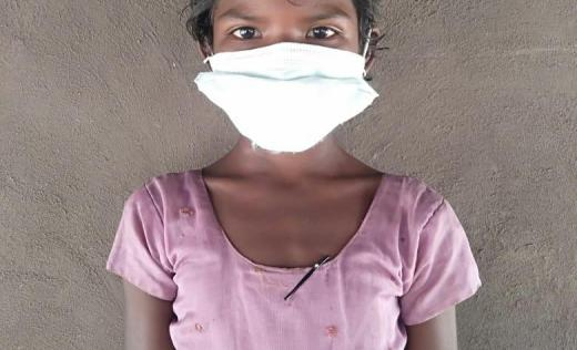 Seetha* 9, in India, wearing a facemask.