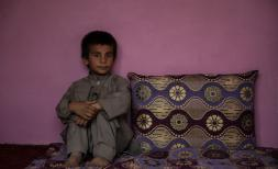 Hemat*, 10, at home in Kabul province