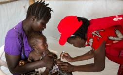 Baby Exodus, six months old, recieves childhood vaccinations in Bidi Bidi camp in North Uganda.