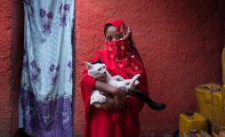 Saada*, 10, with her cat in her home in Harar, Ethiopia. She attends a girls' club at her school, which empowers girls and boys to talk openly about female issues, from child marriage and FGM to sanitation and menstruation.