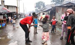 A child in Mathare sanitizing their hands