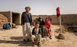 Abdul*, 9, with his grandfather and relatives outside their home in Mazar-e Sharif, Afghanistan.