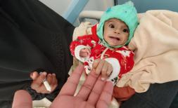 One year old Haifa* is held by her mother Roqea* as she is treated for malnutrition. Sami Jassar/Save the Children
