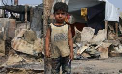 Rifat* 4, in the burnt out shell of the Madrasa (religious educational institution) after the Cox's Bazar fire in March 2021