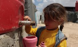 Zaina*, 6 fetching water from the tank in Al Hol camp, north east Syria