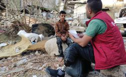 Mubarak*, Save the Children Volunteer in Taiz, Yemen with Bara'a* 11, one of the children he's assisting